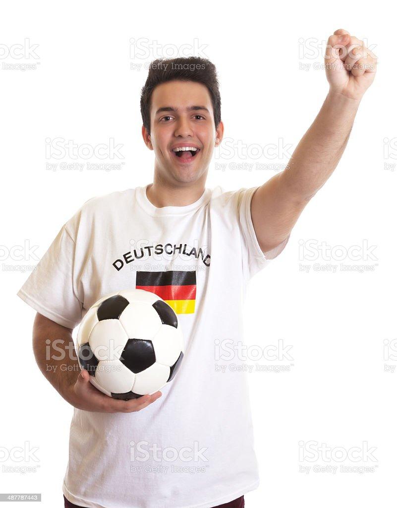Comemorando fã de futebol, com bola de futebol alemão - foto de acervo