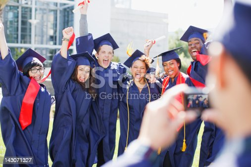 143071519 istock photo Cheering graduates taking picture of themselves 143071327