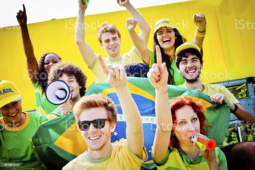 Cheering Group of Brazilian Football Supporters royalty-free stock photo
