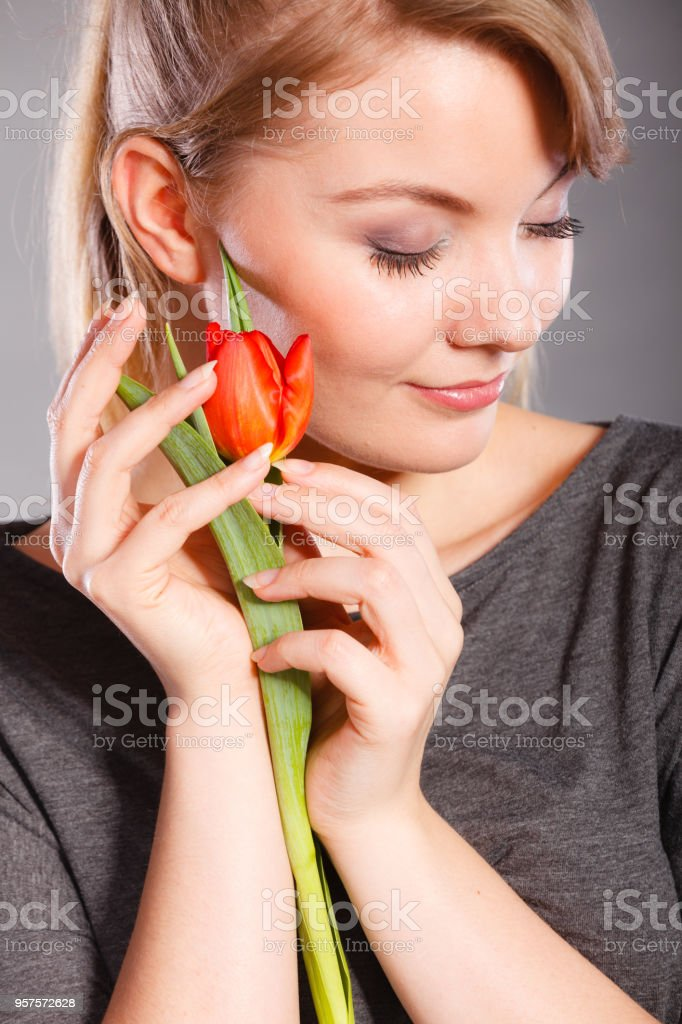 Cheering lady holding flower. stock photo