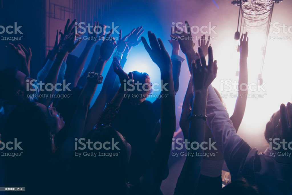 Cheering live show performance concept. Crowd shadow of people at...