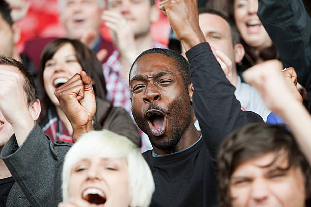 Cheering man at football match  supporter stock pictures, royalty-free photos & images