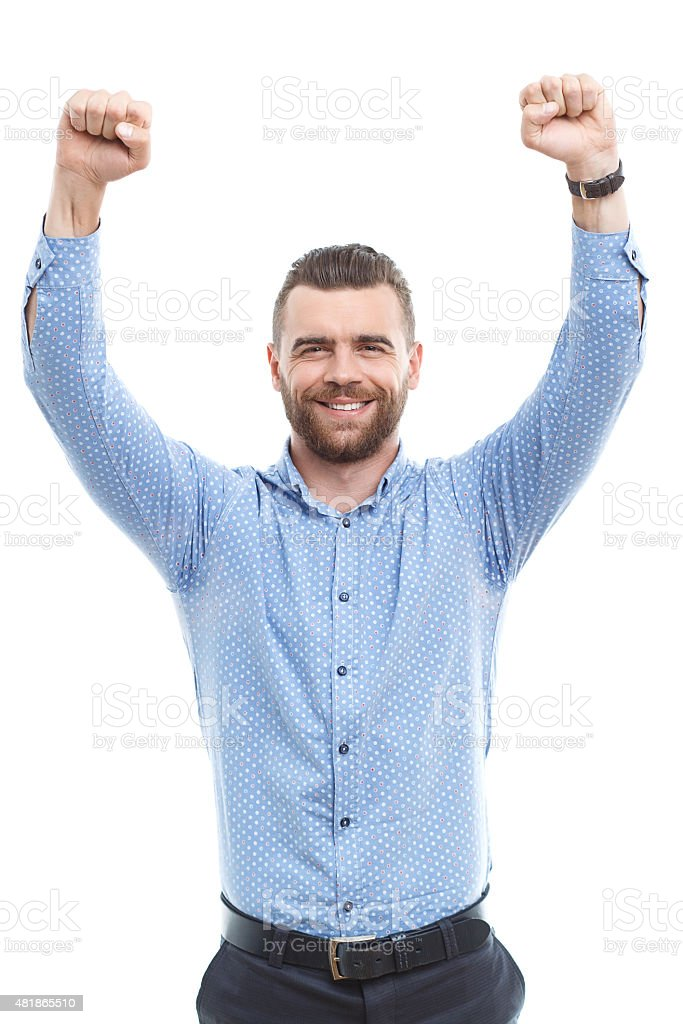 Cheering man with raised arms stock photo