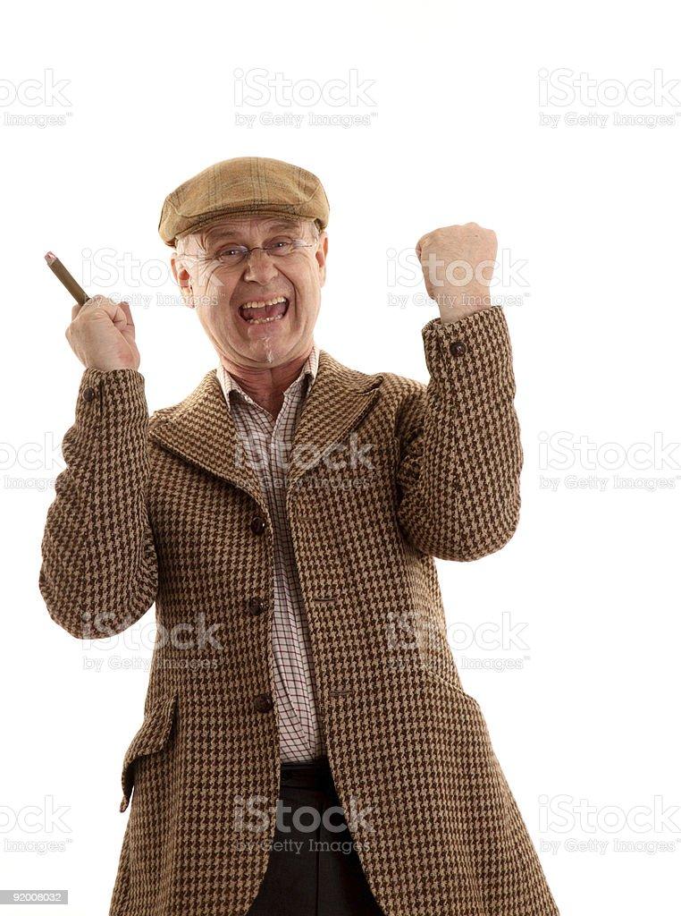 Cheering mature man in tweeds stock photo