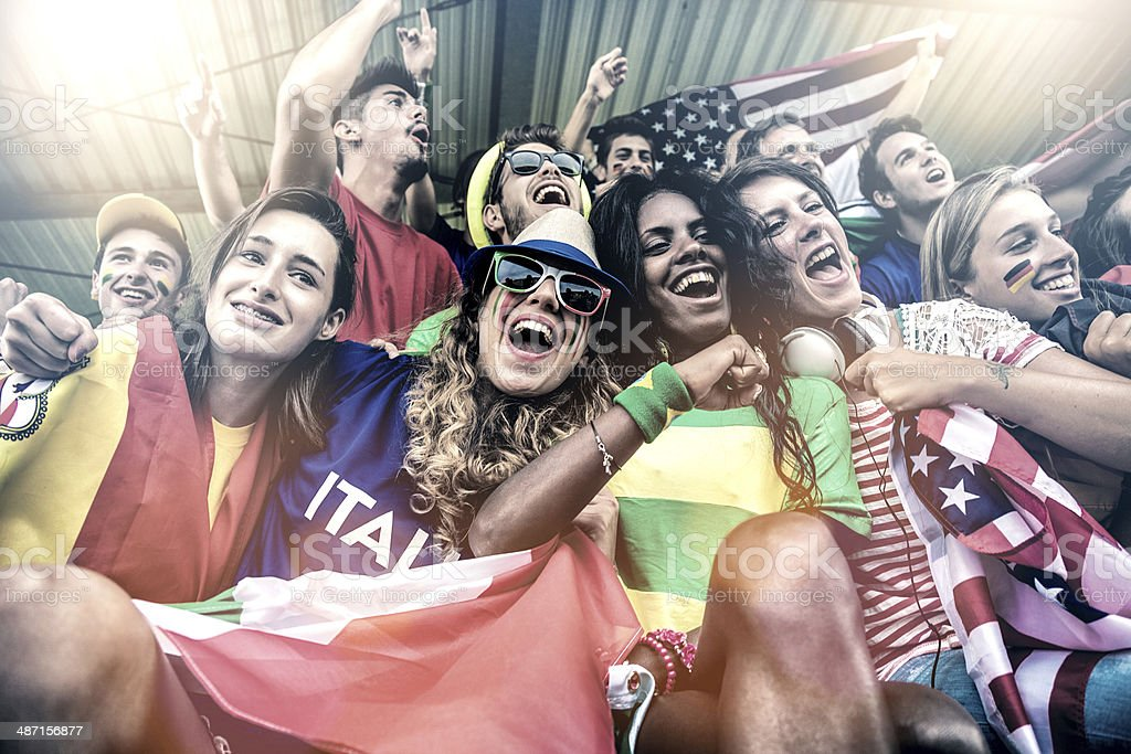 Cheering multi-ethnic game supporters royalty-free stock photo