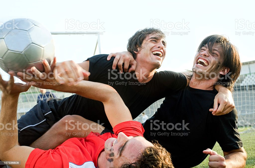Cheering soccer players royalty-free stock photo