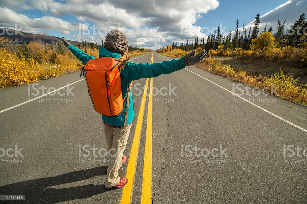 Cheering traveling woman enjoying freedom stock photo