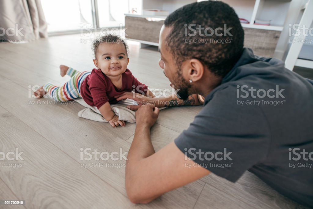 Cheering up a baby stock photo
