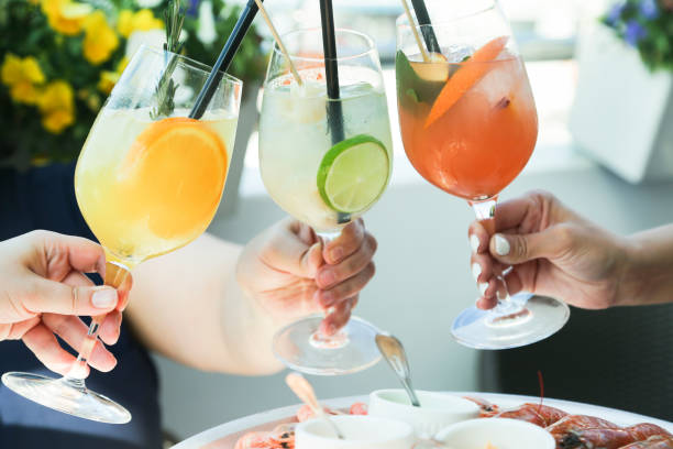 cheering with cocktails - margarita drink stock photos and pictures