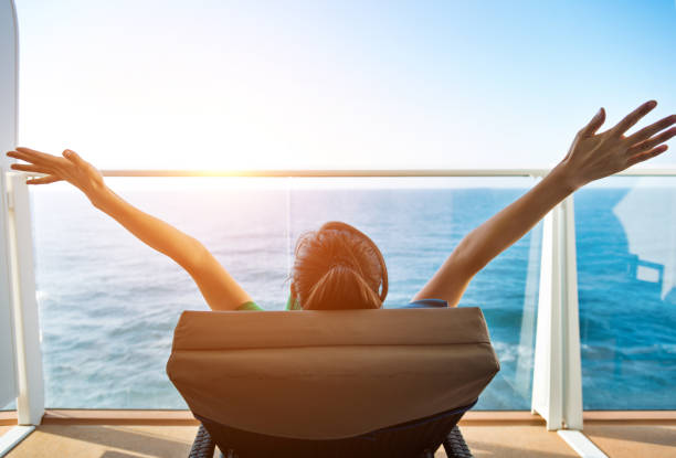 Cheering woman open arms on cruise stock photo