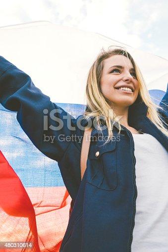 537894724istockphoto Cheering Woman Under Russian Flag 480310614