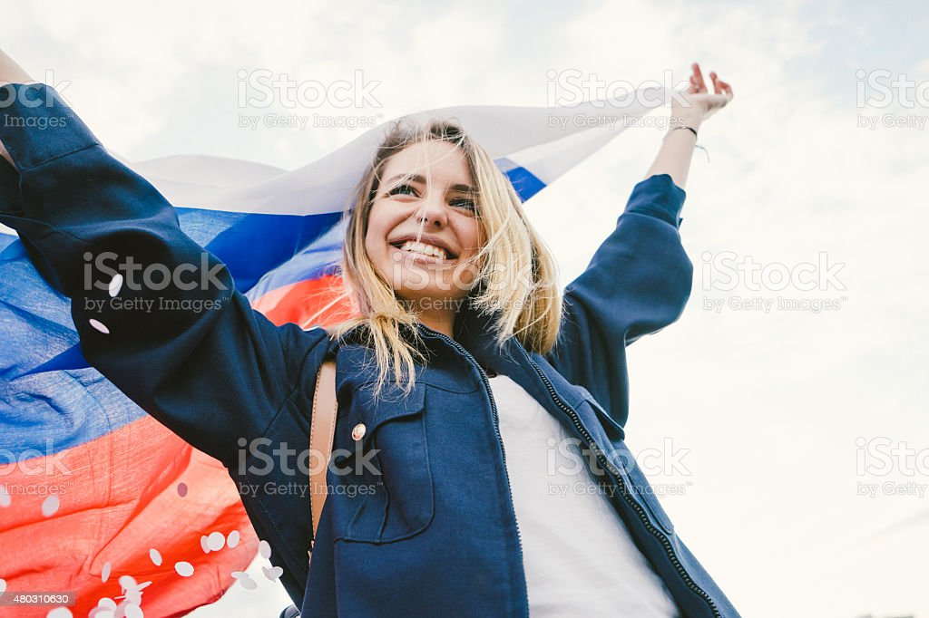 Cheering Woman Under Russian Flag bildbanksfoto