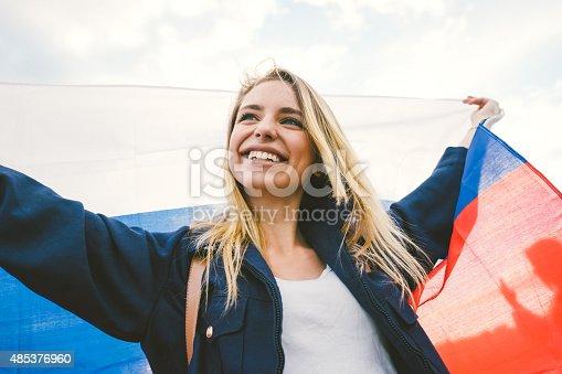 537894724istockphoto Cheering Woman Under Russian Flag 485376960
