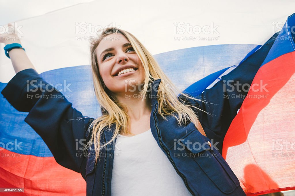 Cheering Woman Under Russian Flag stock photo
