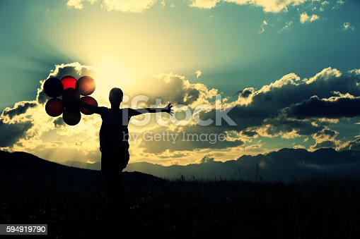637457536 istock photo cheering young asian woman on grassland with colored balloons 594919790