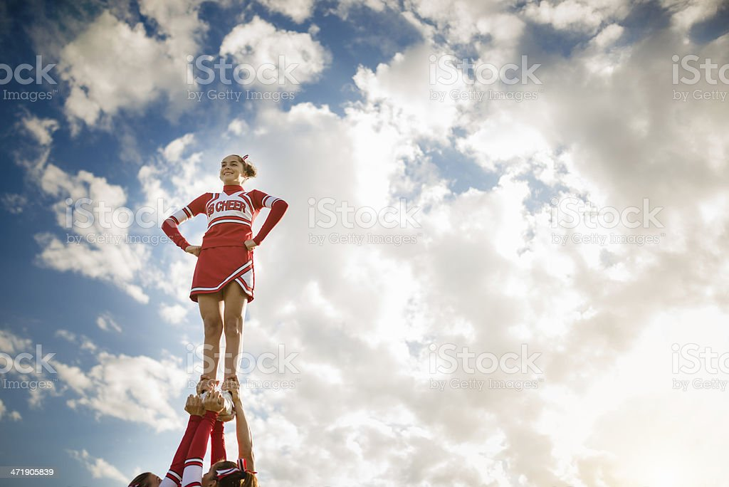 Cheerleadear on top of the success stock photo