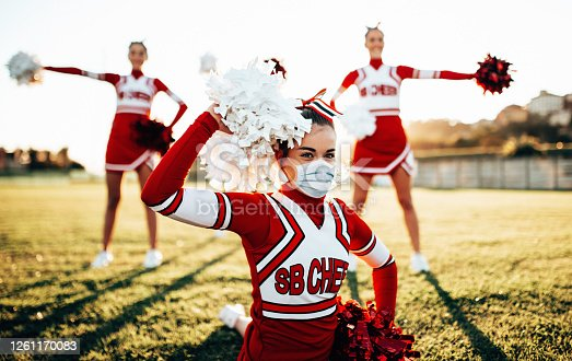 cheerleader doing sport with face mask
