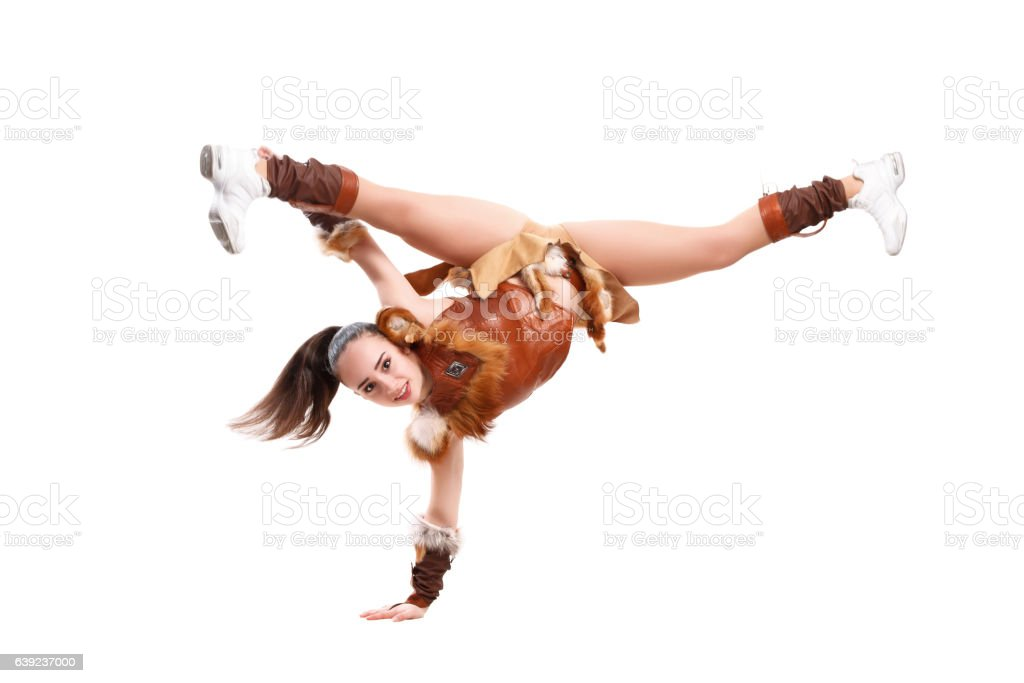 cheerleader dressed in a warrior costume standing on one hand stock photo