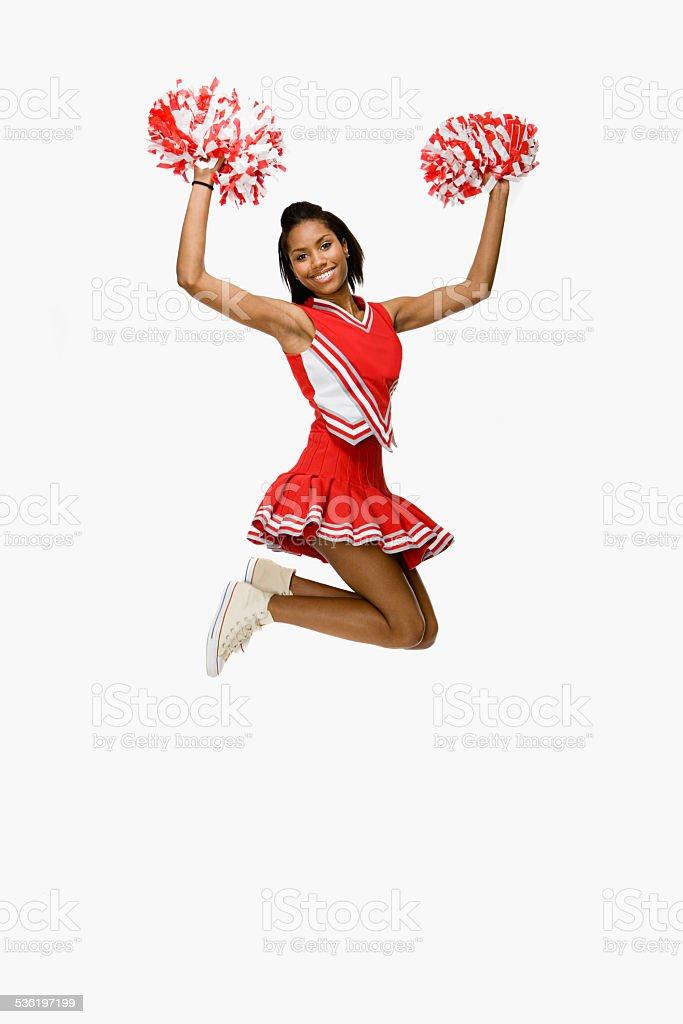 Cheerleader jumping stock photo
