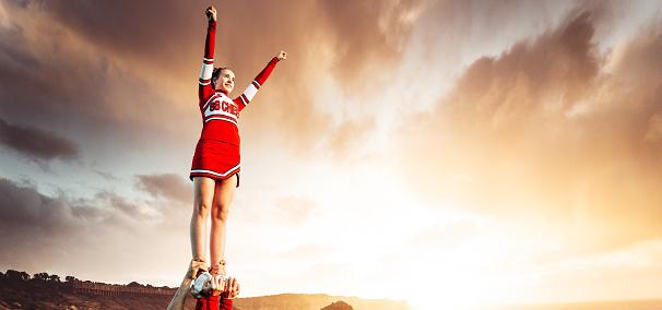cheerleader on top of the world