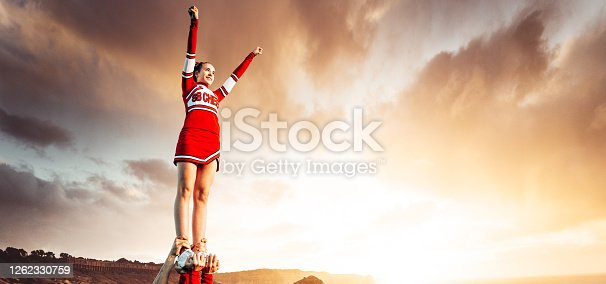 cheerleader on top of the world