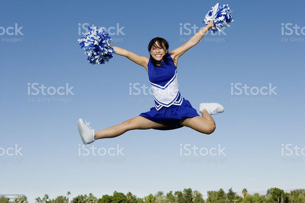Cheerleader Performing Cheer in Mid-Air royalty-free stock photo