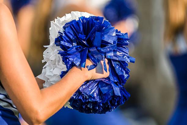 cheerleader pom poms - pompon stockfoto's en -beelden