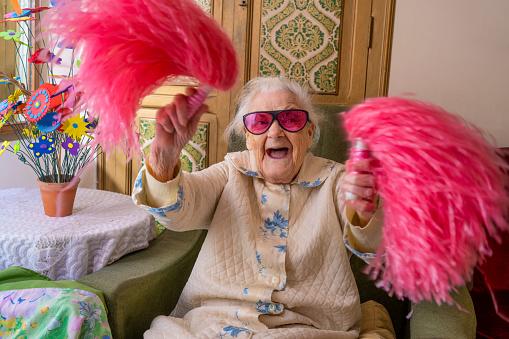 Cheerleader pom-pom elderly woman happy