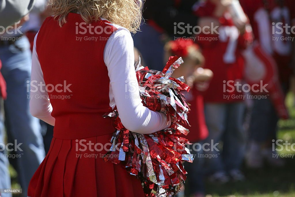 Cheerleader preparing for the game stock photo