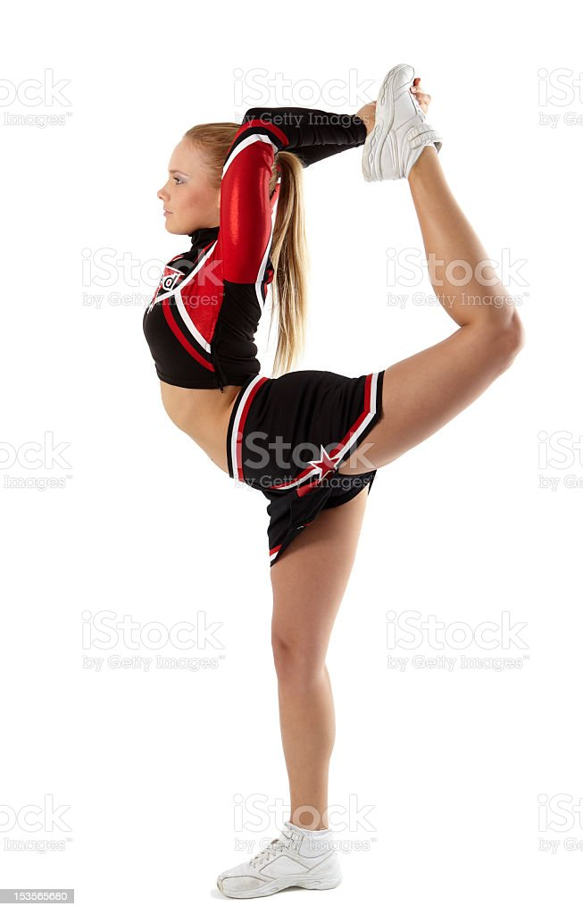 Cheerleader side view wearing sneakers balanced on one shoe stock photo