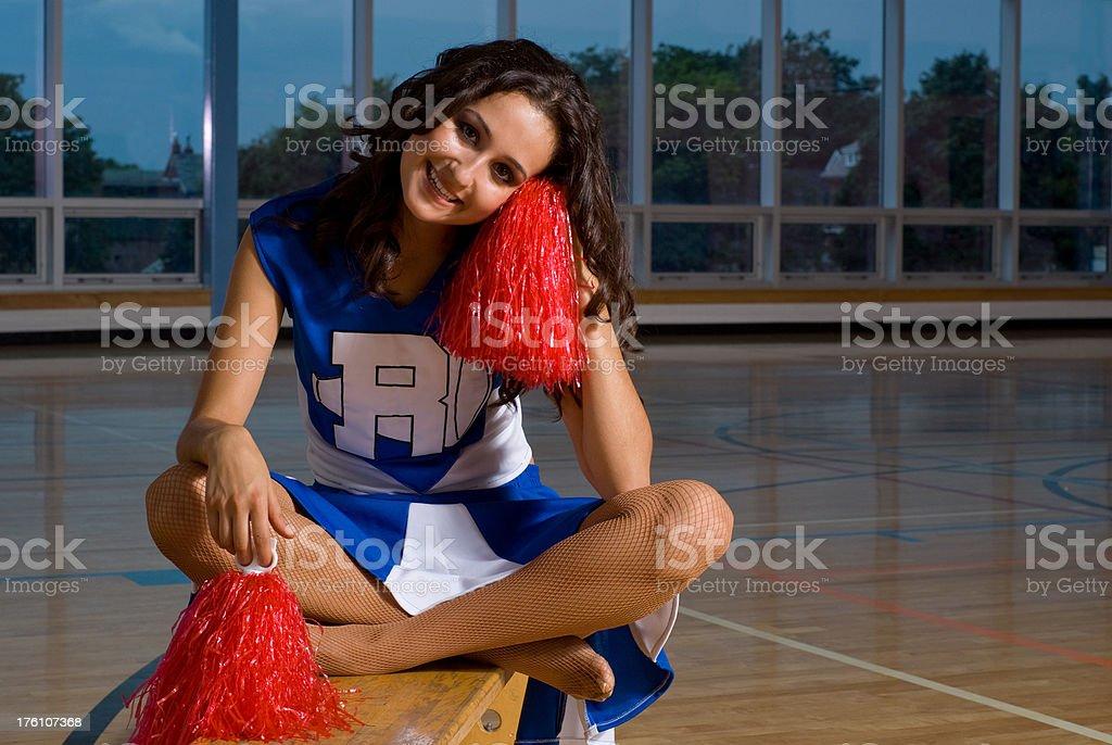 Cheerleader Sitting in a Gym stock photo