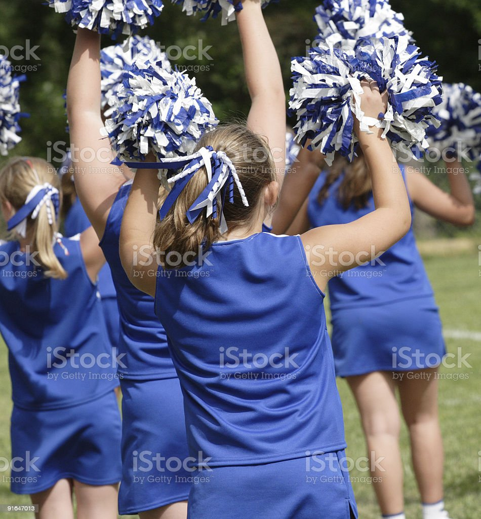 Cheerleaders Cheering With PomPoms royalty-free stock photo