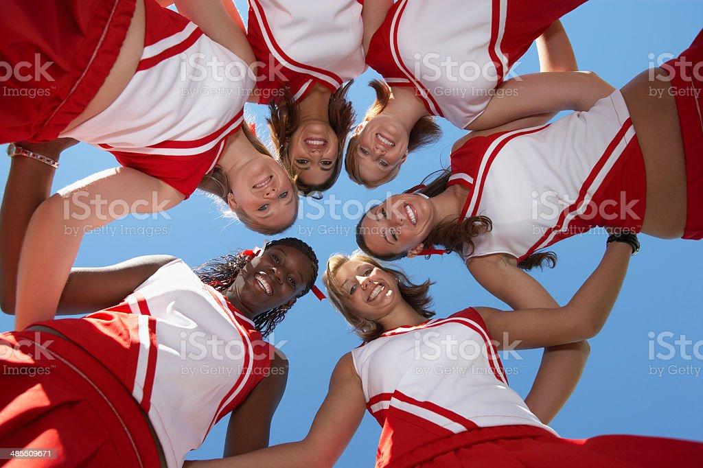 Cheerleaders in Huddle stock photo