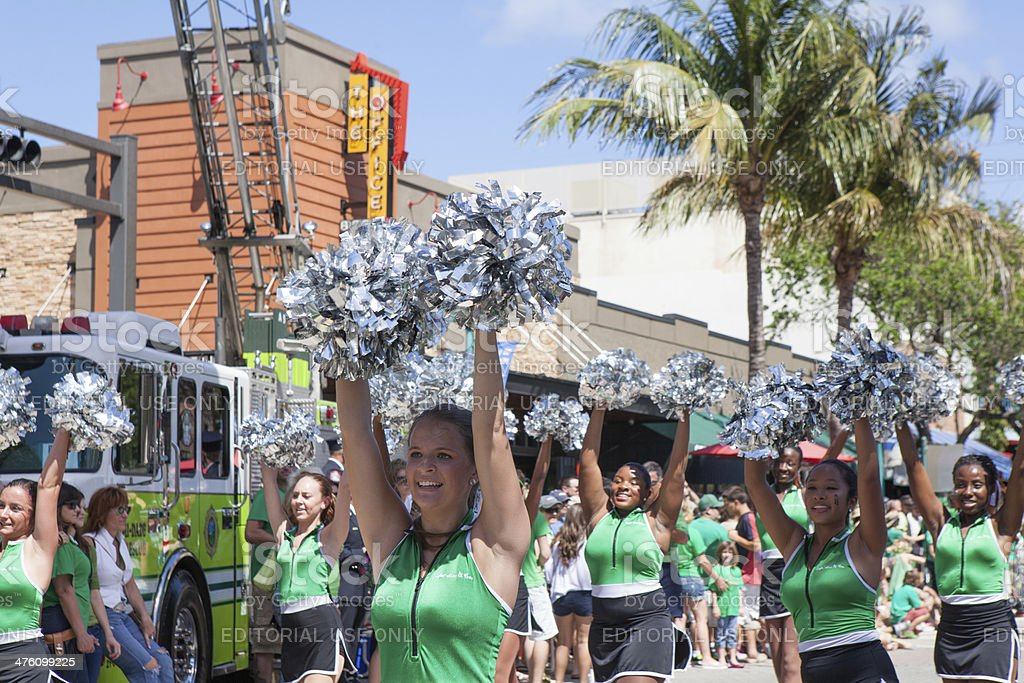 Cheerleaders march in St. Patrick's Day Parade stock photo