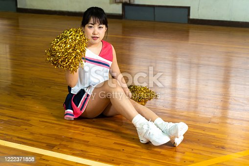 Cheerleaders practicing in the gym