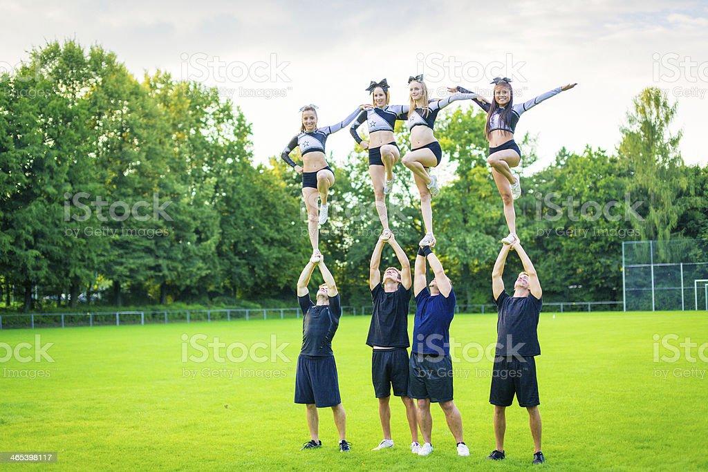 cheerleaders practicing stock photo
