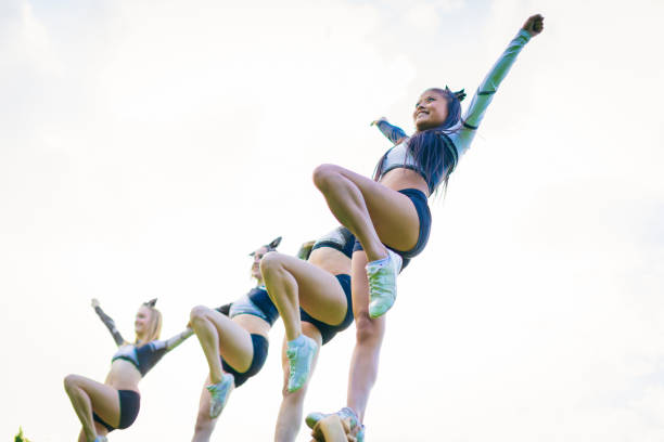cheerleaders practicing stock photo