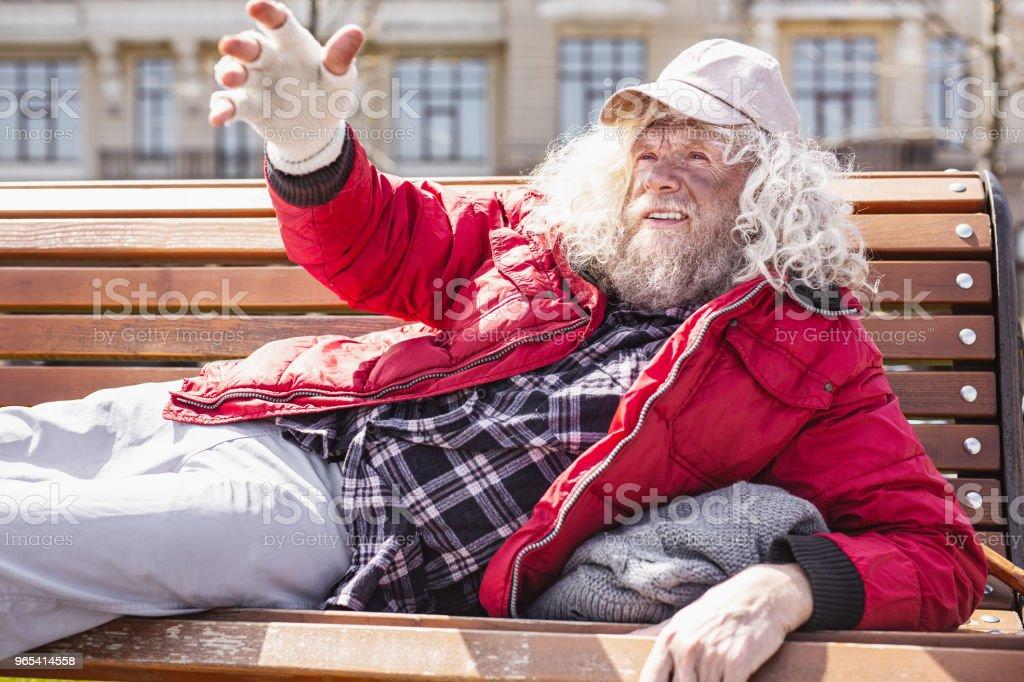 Cheerless poor man stretching out his hand zbiór zdjęć royalty-free