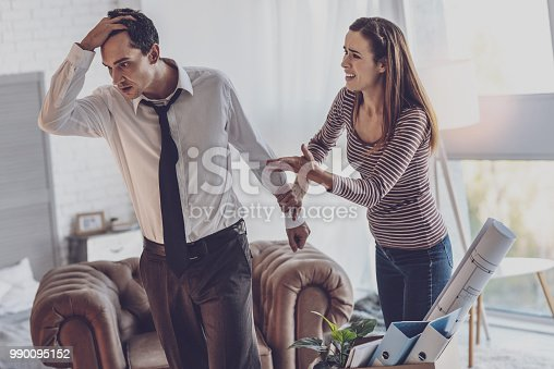 Family quarrel. Cheerless young woman fighting with her husband while being unhappy in relationships