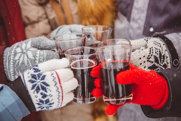 cheers and happy holidays - mulled wine stock photos and pictures