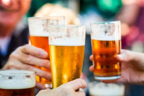 Cheers Celebration Toast with Pints of Beer stock photo