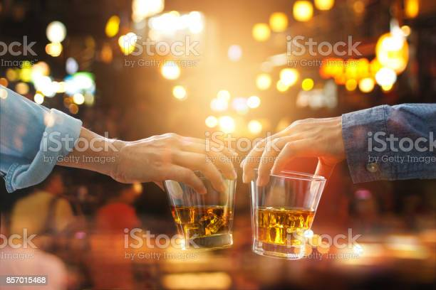Cheers clinking of friends with bourbon whisky drink in party night picture id857015468?b=1&k=6&m=857015468&s=612x612&h=k122gusucjpqqtx2uf0aefxsncncb7o9i7qb4nwflgs=