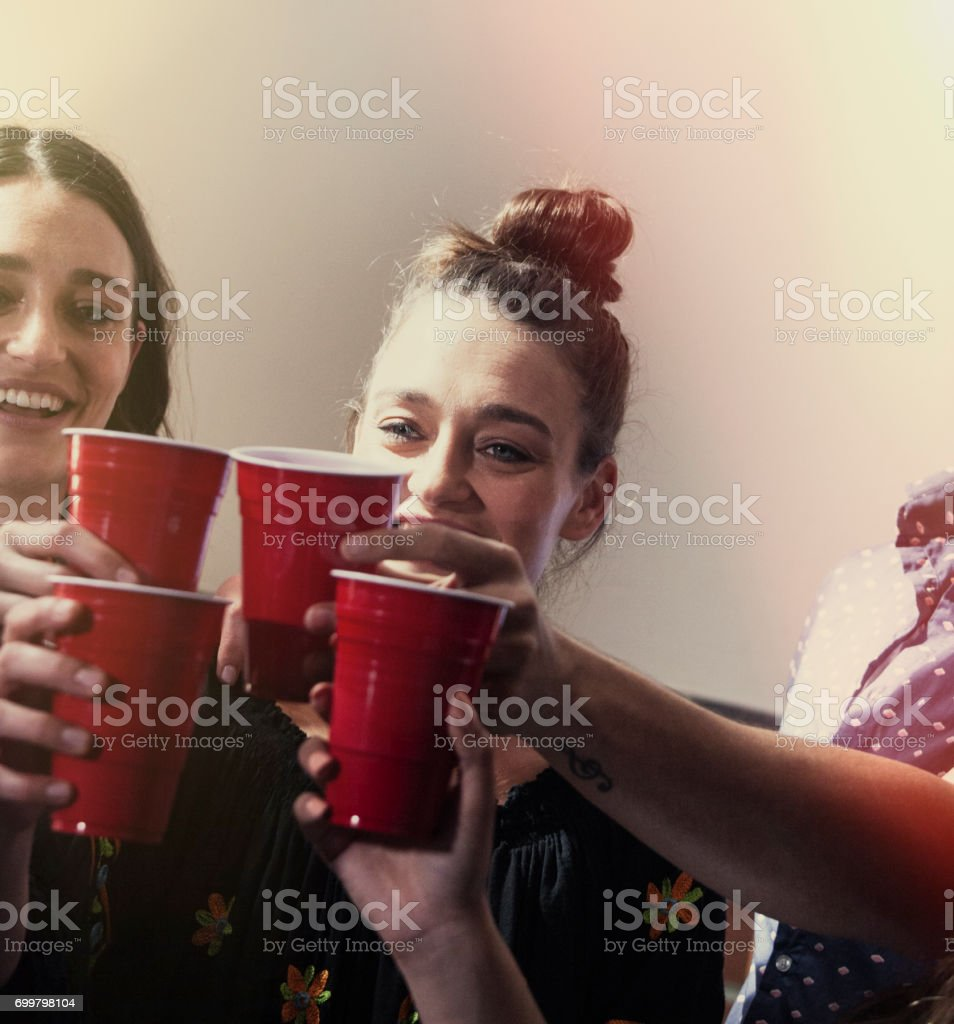 Cheers- drinking at a party stock photo