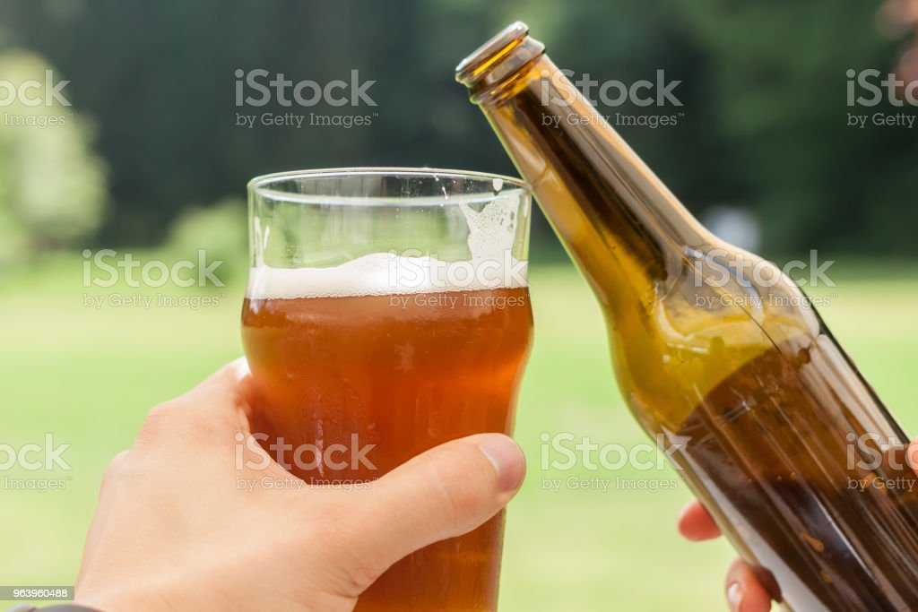 cheers glass and bottle of beer - Royalty-free Alcohol Stock Photo