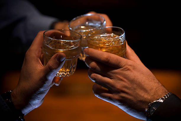 cheers! - whiskey stock photos and pictures