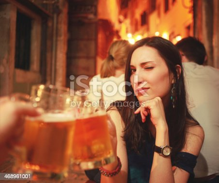 Pretty brunette celebrating with draft beer.