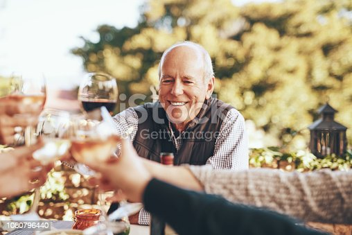 Cropped shot of people sharing a toast while having dinner together