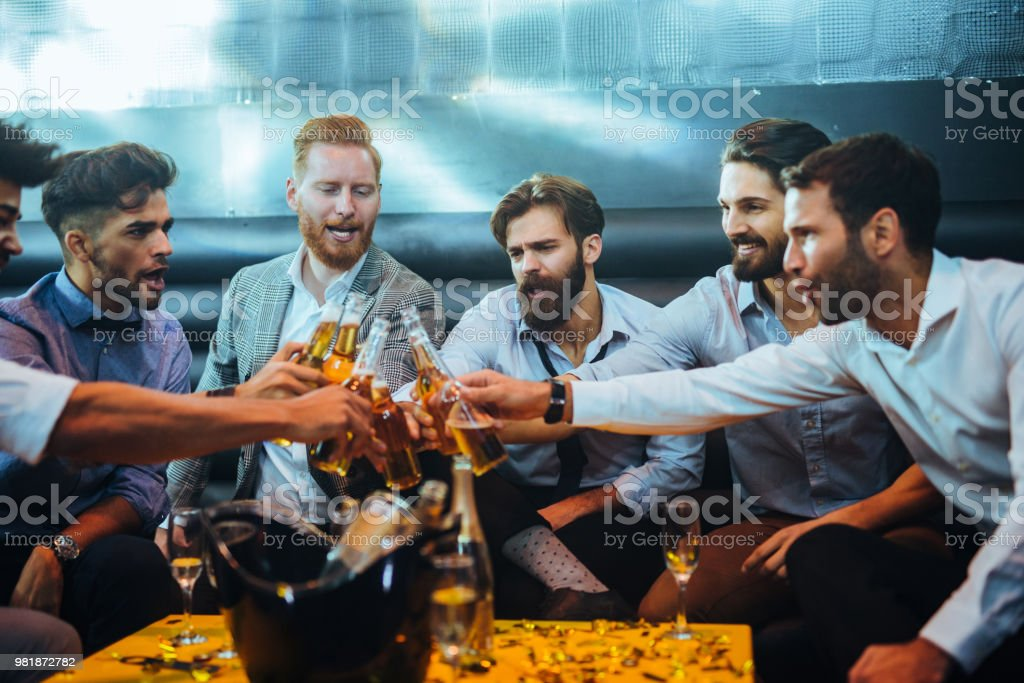Cheers to good times with mates ! stock photo