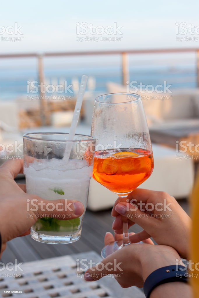 cheers two glasses with cocktails royalty-free stock photo
