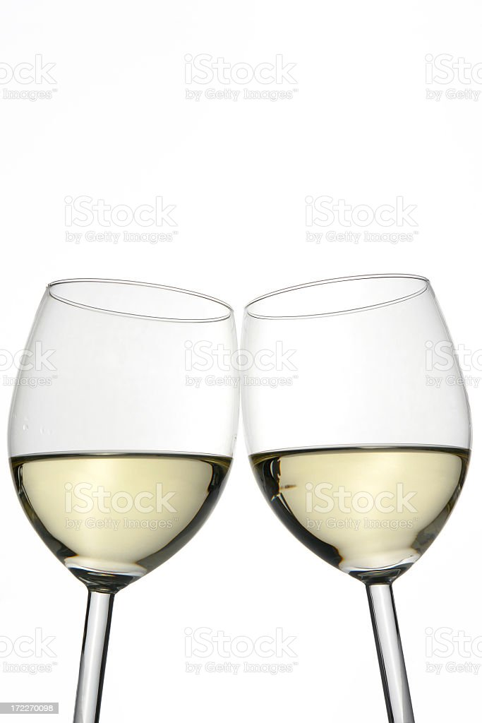Cheers! Two white wine glasses isolated on white, studio shot royalty-free stock photo